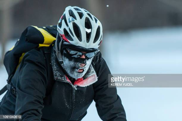 A bicyclist passes through heavy frost in Nokomis parkway south west Minneapolis as temperatures in the area dipped below freezing overnight in...