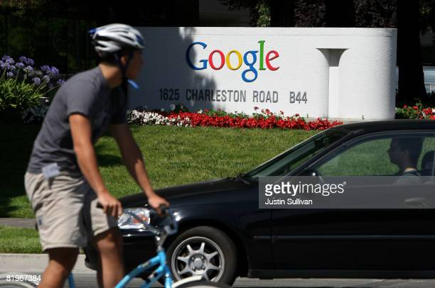 Bicyclist rides by a sign outside of the Google headquarters July 17, 2008 in Mountain View, California. Google Inc. Is expected to announce an...