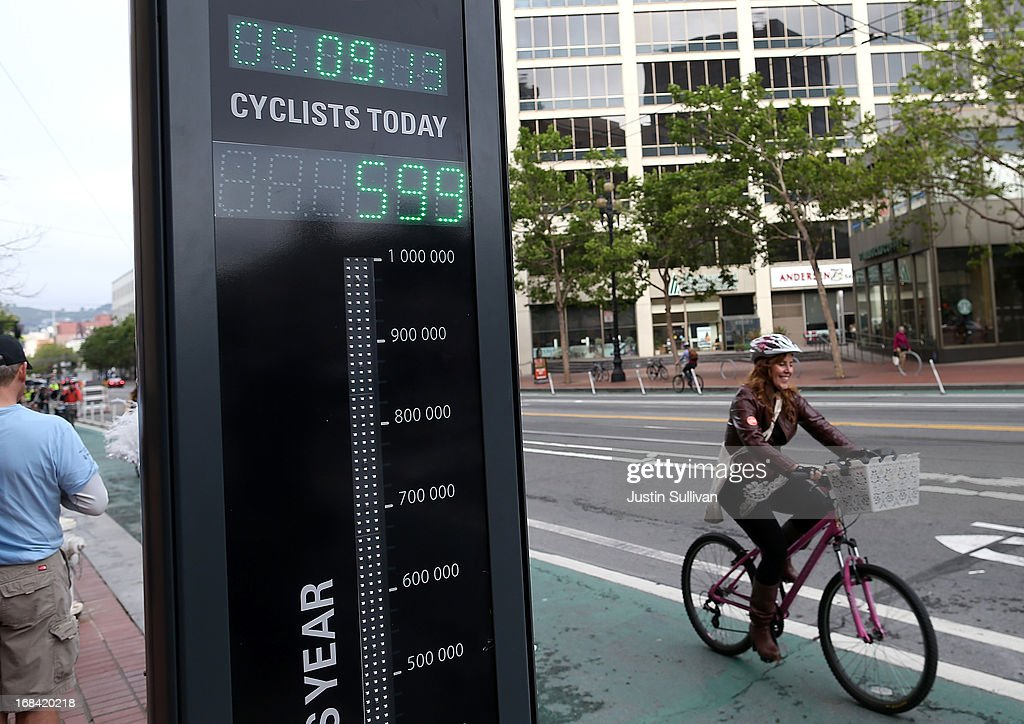 A bicyclist rides by an automated real-time bike counter on Market Street on May 9, 2013 in San Francisco, California. The San Francisco Municipal Transportation Agency has installed an automated real-time bike counter, also known as a bicycle barometer, on Market Street that will display daily and annual counts. According to the SFMTA, the number of cyclists on the streets of San Francisco has surged 71 percent between 2006 and 2011.