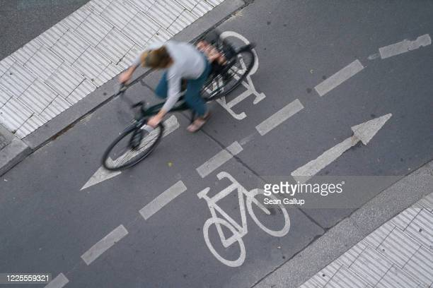 A bicyclist rides on a twoway bike lane next to a street in the city center on May 09 2020 in Berlin Germany The city of Berlin has been accelerating...