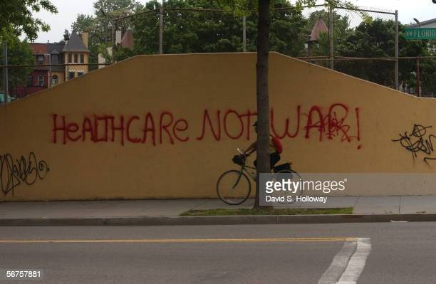 A bicyclist rides past a painted antiwar protest May 15 2003 in the Adams Morgan neighborhood of Washington DC