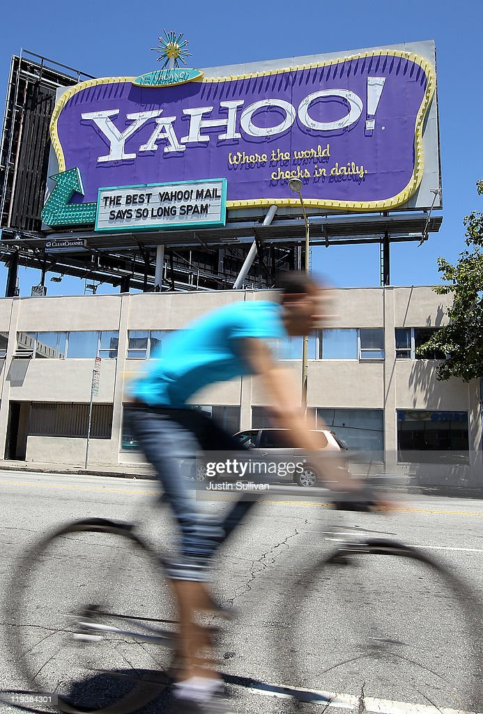 A bicyclist rides past a Yahoo! billboard on July 19, 2011 in San Francisco, California. Yahoo Inc. reported second quarter earnings of $237 million, or 18 cents per share, compared to $213 million, or 15 cents per share, compared to one year ago.