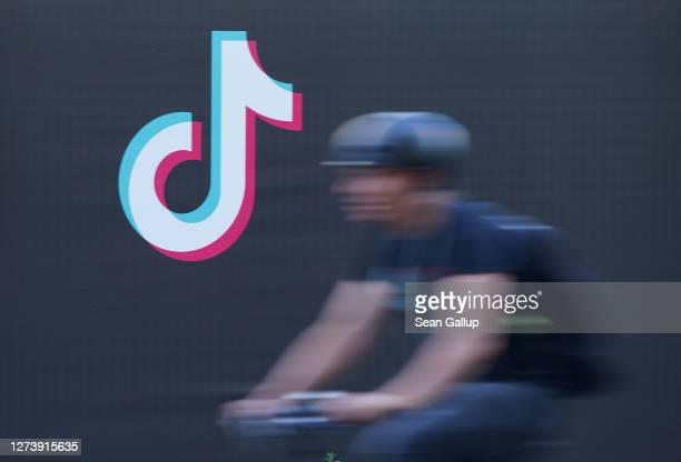 Bicyclist rides past an advertisement for social media company TikTok on September 21, 2020 in Berlin, Germany. U.S. President Donald Trump has given...