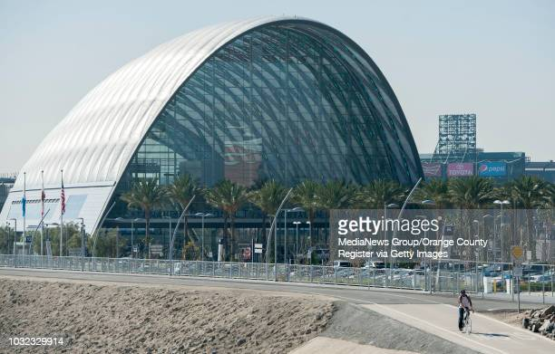 A bicyclist rides past the Anaheim Regional Intermodal Transportation Center Friday The state plans to spend $68 billion on a highspeed rail line but...
