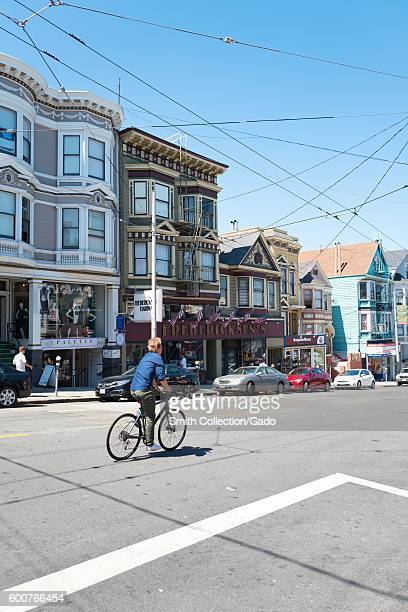 A bicyclist rides past Victorian homes on Fillmore Street in the Cow Hollow neighborhood of San Francisco California August 28 2016