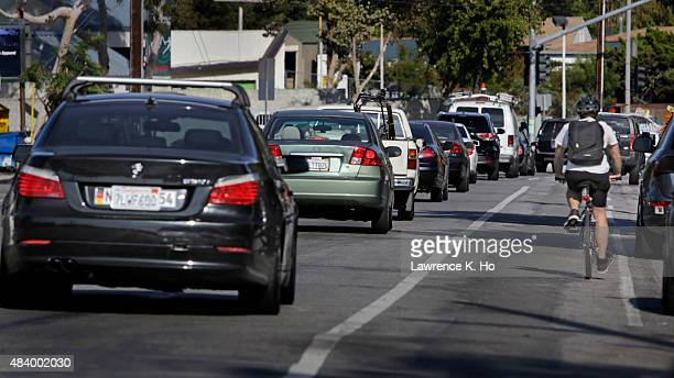 A bicyclist riding alongside the traffic on Rowena Ave near West Silver Lake Dr to Lakewood Ave N on August 13 2015 in Los Angeles California As part...
