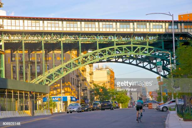 bicyclist under train station viaduct, harlem, nyc - viaduct stock pictures, royalty-free photos & images