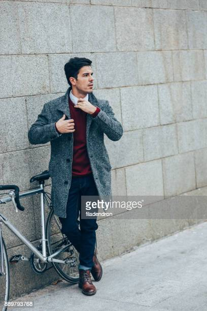 Bicyclist waiting outdoors