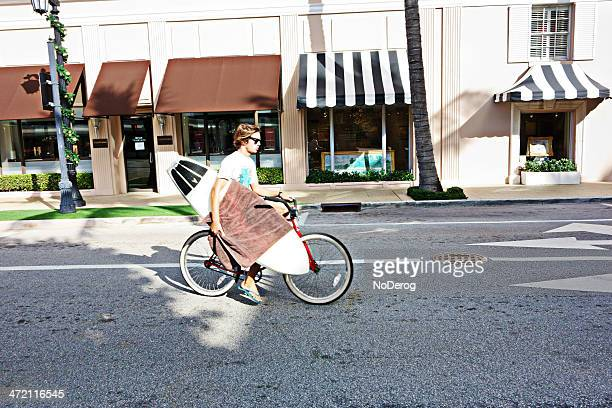 Bicyclist with surf board