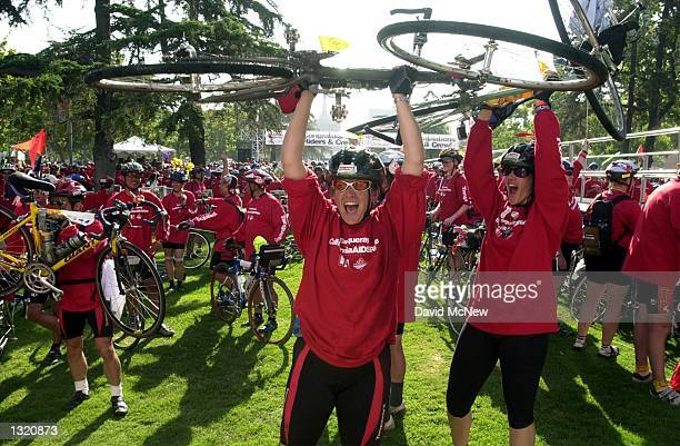 Bicyclists celebrate after completing the California eighth annual AIDSRide June 9 2001 in Los Angeles CA More than 2000 bicyclists rode from San...