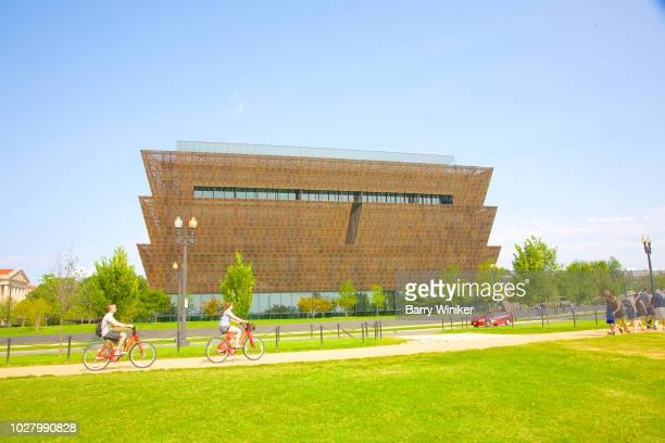 bicyclists near national museum of african american history and culture in d.c. - history museum stock pictures, royalty-free photos & images