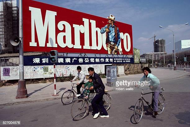 Bicyclists Pass Marlboro Billboard in China