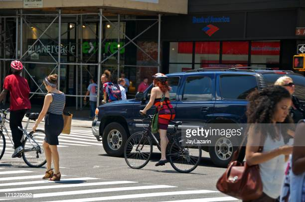 bicyclists & pedestrians at e.23rd st, manhattan, nyc - next to stock pictures, royalty-free photos & images