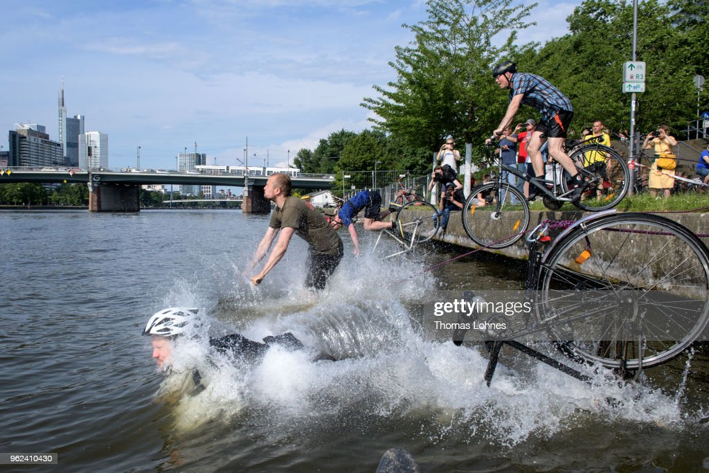 Bicyclists Drive Into Main River In Protest