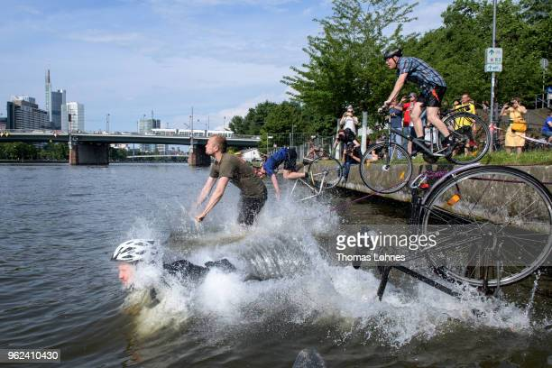 Bicyclists ride into the Main River during an organized protest action on May 25 2018 in Frankfurt Germany The cyclists were seeking support for an...