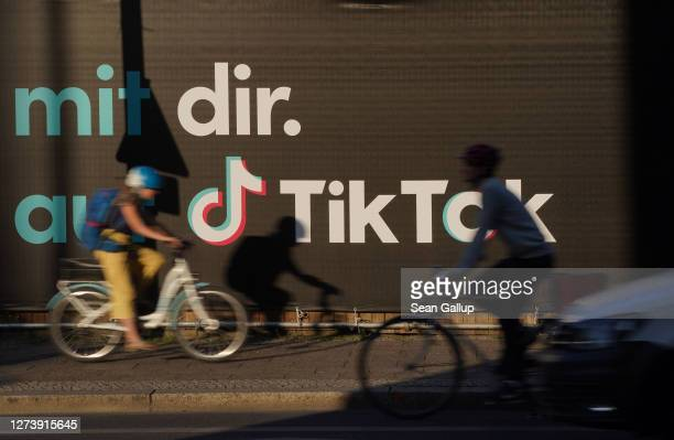 Bicyclists ride past an advertisement for social media company TikTok on September 21, 2020 in Berlin, Germany. U.S. President Donald Trump has given...