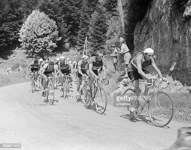 Bicyclists round a corner in the 10th stage of the 1951 Tour de France Fausto Coppi leads the group followed by Hugo Koblet | Location Between...