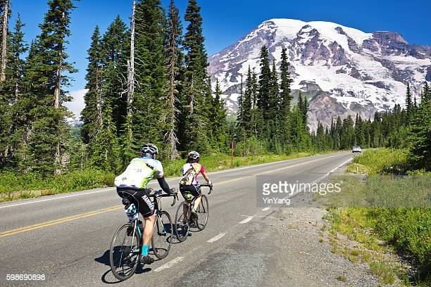 Bicyclists Touring Mount Rainier National Park, Washington
