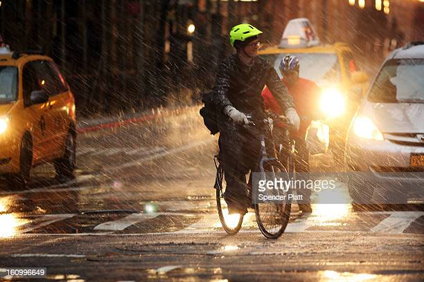 Bicyclists wait at a light in wind snow and sleet as Manhattan experiences a major winter storm on February 8 2013 in New York City New York City...
