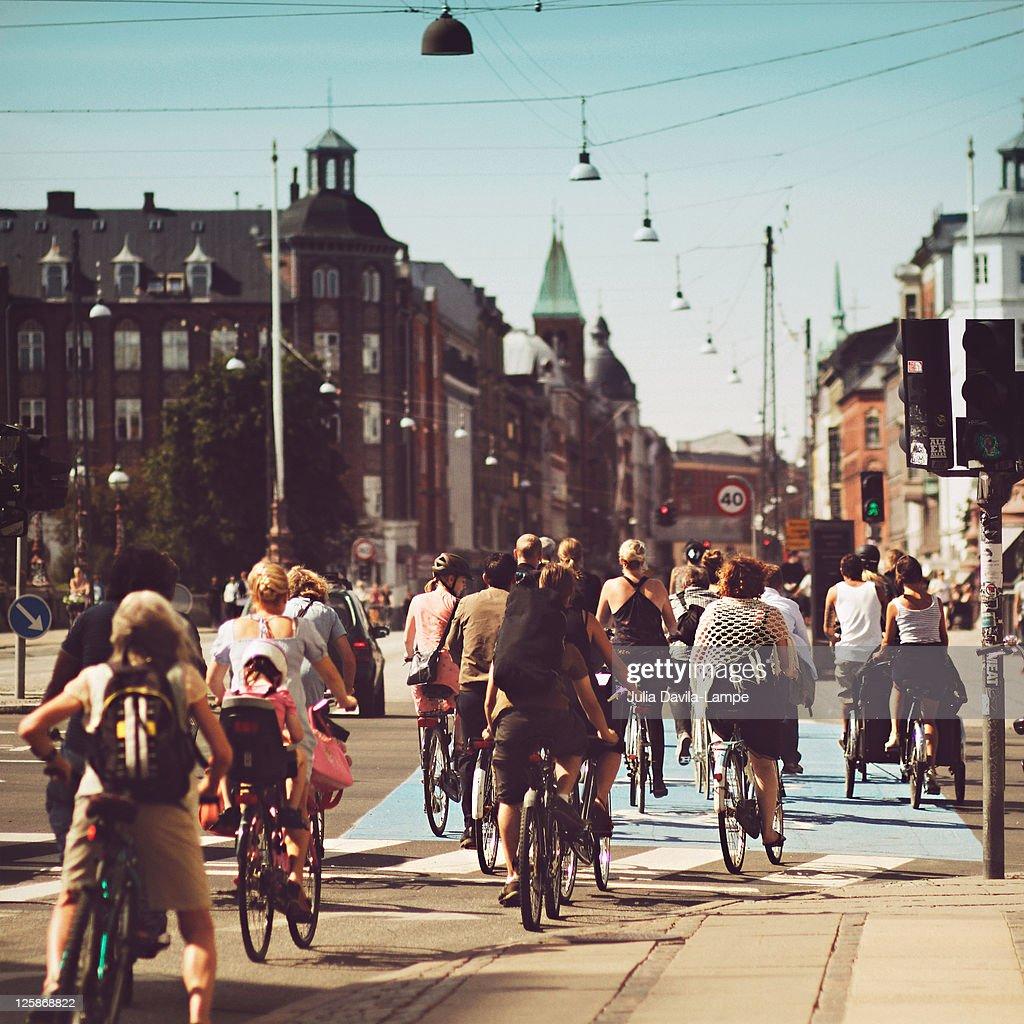 Bicyle riders on street in Copenhagen : Stock Photo