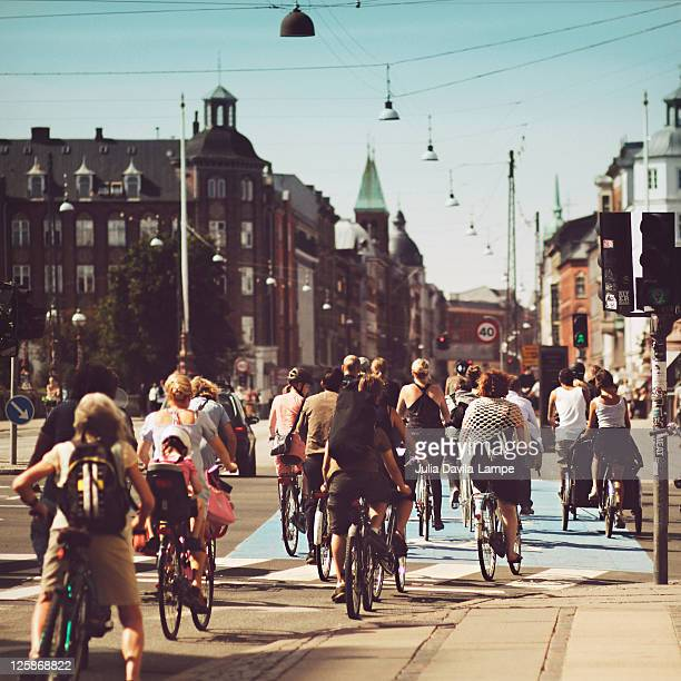 bicyle riders on street in copenhagen - copenhague photos et images de collection