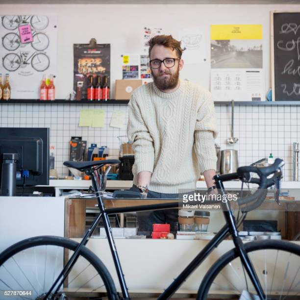 bicyle shop owner behind counter