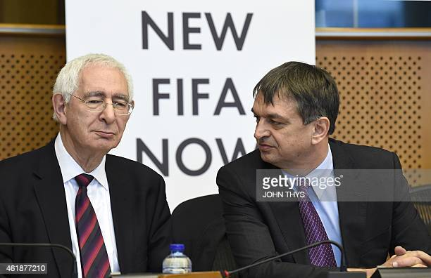 Bid chairman David Triesman speaks to former FIFA deputy general secretary Jerome Champagne before a summit on FIFA at the European Union...