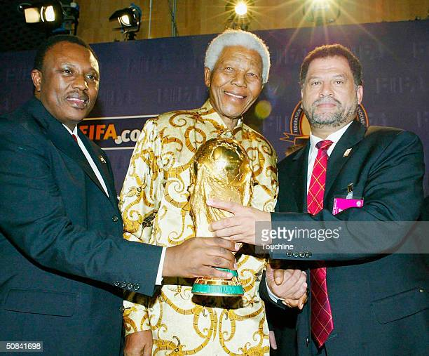 Bid Chairman Irvin Khoza Former South African President Nelson Mandela and Bid CEO Danny Jordaan pose with the world cup trophy during the FIFA 2010...