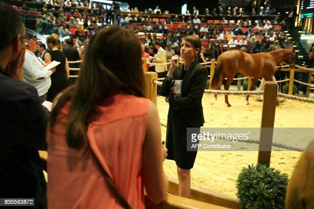 A bid spotter gestures on August 19 2017 during the Yearlings sales one of the world renowned annual thoroughbred sales in Deauville This year's...