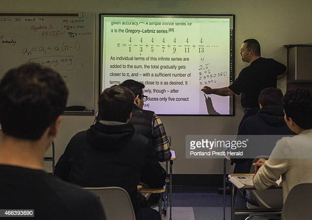 Biddeford High School math teacher Jon Jacques instructs his calculous class on a lesson related to the pi figure at Biddeford High School in...