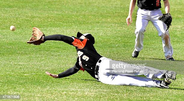 Biddeford Nick Conley dives for the fly ball hit to center field as Deering hosts Biddeford in high school baseball action at Hadlock Field He missed...