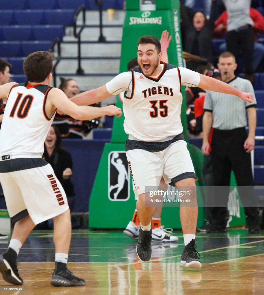 Biddeford vs Brunswick boys Class A quarterfinal. Zachary Reali of Biddeford, right, celebrates with teammate Carter Edgerton after he grabbed an offensive rebound and tipped it in at the buzzer to beat Brunswick.