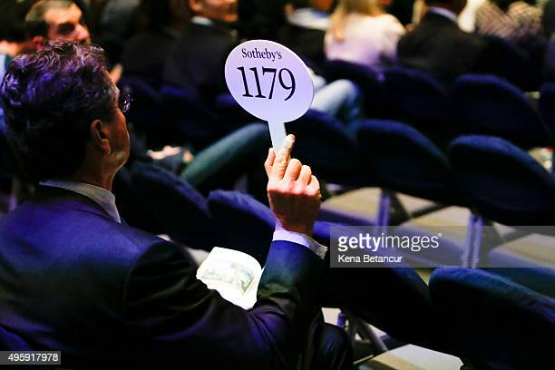 A bidder attends an auction at Sotheby's on November 5 2015 in New York City On the second day of Sotheby's fall art auction the house is offering...