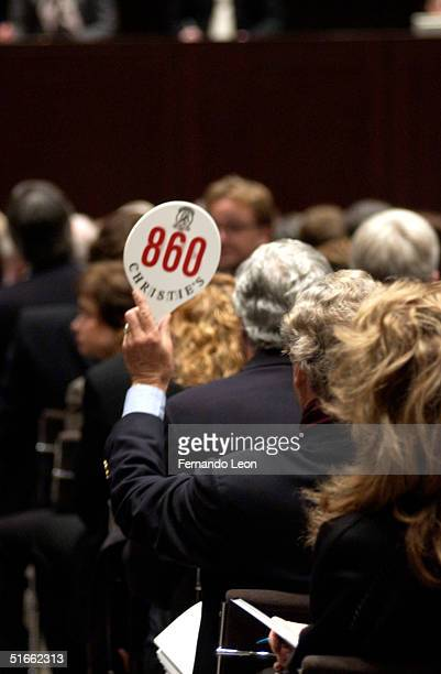 A bidder raises his paddle to identify himself to the auctioneer after successfully closing the auction November 3 2004 at Christie's in Rockefeller...