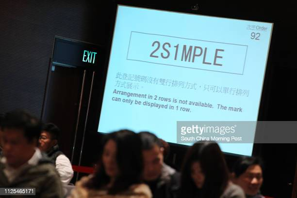 Bidding for the vehicle registration plate '2S1MPLE' during the auction of Personalised Vehicle Registration Marks at Hong Kong Convention and...