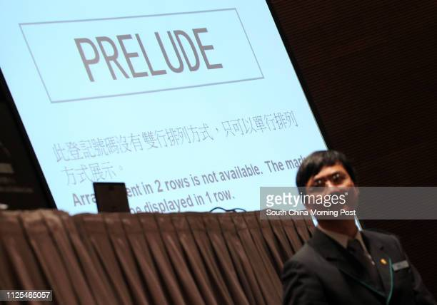 Bidding for the vehicle registration plate 'PRELUDE' during the auction of Personalised Vehicle Registration Marks at Hong Kong Convention and...
