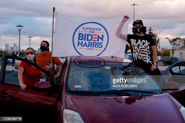 Biden-Harris supporters gather for a drive-in rally with former US President Barack Obama in Philadelphia, Pennsylvania on October 21, 2020. - Former...