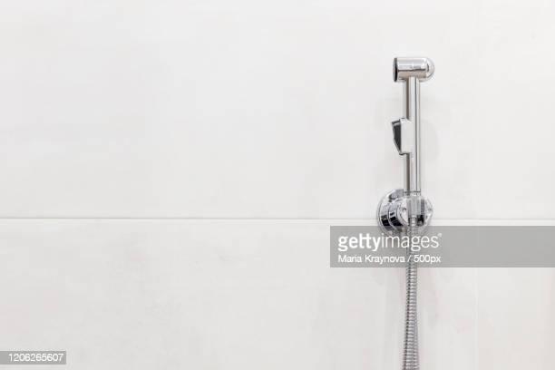 bidet shower on white background - bidé bildbanksfoton och bilder