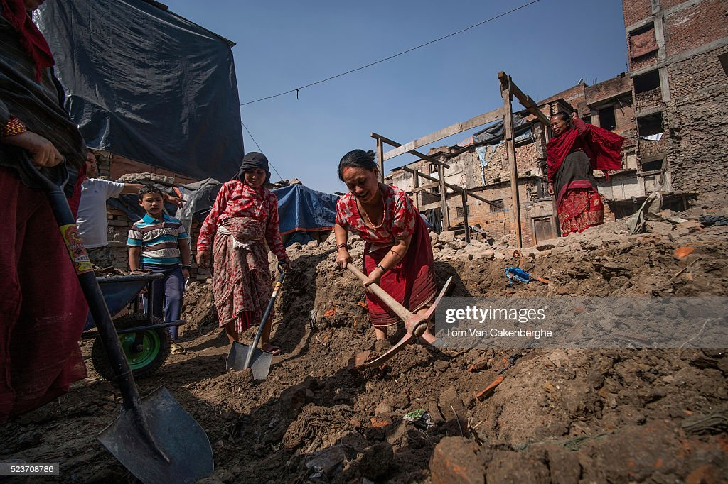 Bidhya Laxmi Prajapati, 45, works with a pick axe as she clears debris at her former house damaged during the April 2015 earthquake, together with family and neighbours on April 24, 2016 in Kathmandu, Nepal. Bidhya recently started rebuilding her house which collapsed during last year's earthquake after deciding not to wait any further for compensation promised by the government. A 7.8-magnitude earthquake struck Nepal close to midday on April 25 lasts year. It was Nepal's worse earthquake in history as an estimated 9,000 people died and countless towns and villages across central Nepal were destroyed. Based on reports, the government promised 2,000USD to affected households but has only paid out a fraction of the amount so far and an estimated 660,000 families are still living in sub-standard temporary shelters or unsafe accommodation one year later.