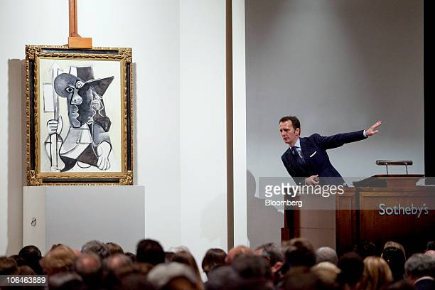 Bids are placed on Pablo Picasso's 'Homme au fanion' during Sotheby's Impressionist Modern Art evening sale in New York US on Tuesday Nov 2 2010 The...