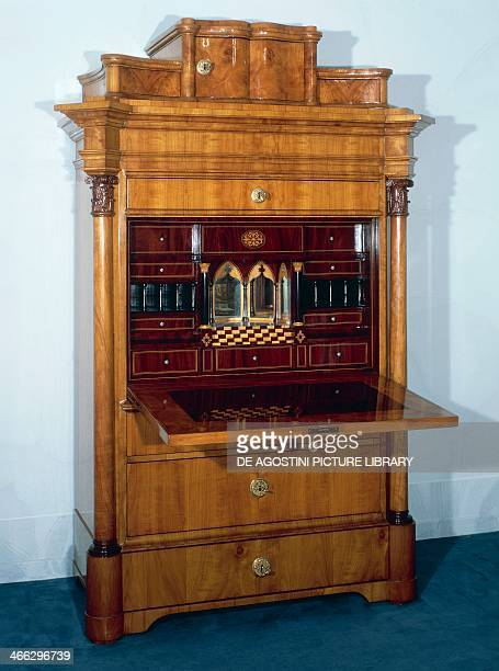 Biedermeier style drop leaf secretary with cherrywood veneer finish, by Schmidt, 1841-1843, drop leaf open. Austria, 19th century.