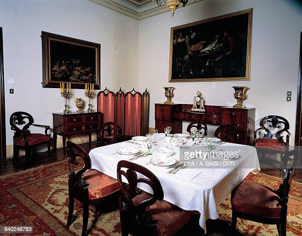 Biedermeierstyle dining room with Meissen porcelain service laid on the table and on the sideboard a wedding gift from the King of Saxony Frederick...