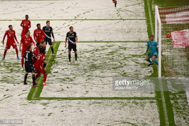 Bielefeld's German defender Amos Pieper scores the 0-2 goal past Bayern Munich's German goalkeeper Manuel Neuer during the German first division...