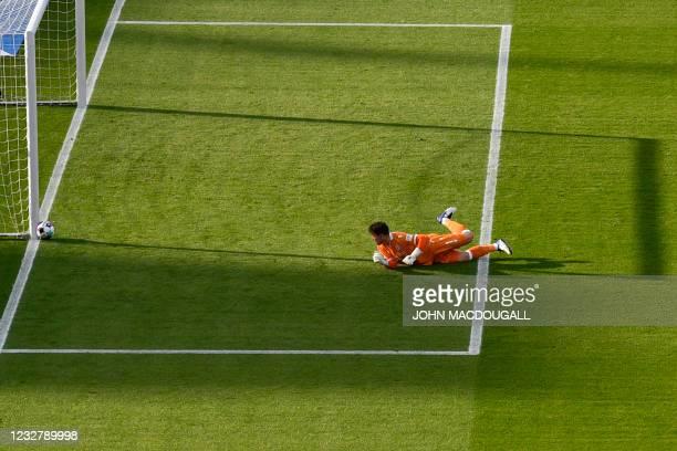 Bielefeld's German goalkeeper Stefan Ortega eyes the ball coming off the post during the German first division Bundesliga football match Hertha...