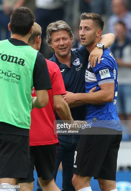 Bielefeld's goal scorer Andraz Sporar celebrates his 21 goal together with coach Jeff Saibene after the ending of the German 2 Bundesliga soccer...