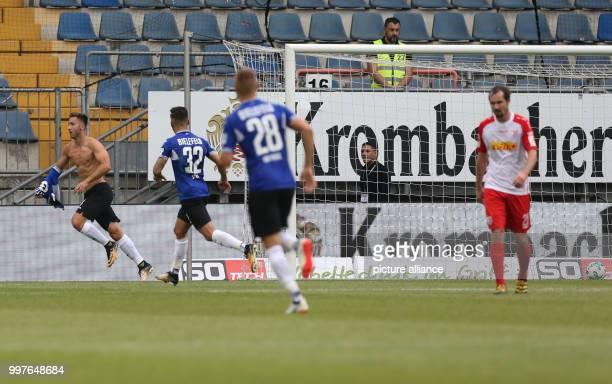 Bielefeld's goal scorer Andraz Sporar celebrates his 21 goal with Keanu Staude And Florian Hartherz during the German 2 Bundesliga soccer match...