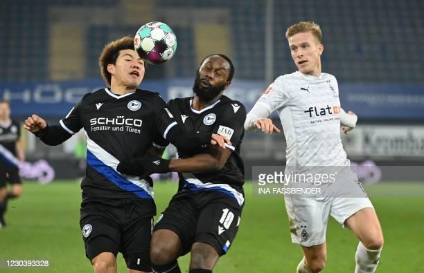 Bielefeld's Japanese forward Ritsu Doan , Bielefeld's German midfielder Reinhold Yabo and Borussia Moenchengladbach's Swedish defender Oscar Wendt...
