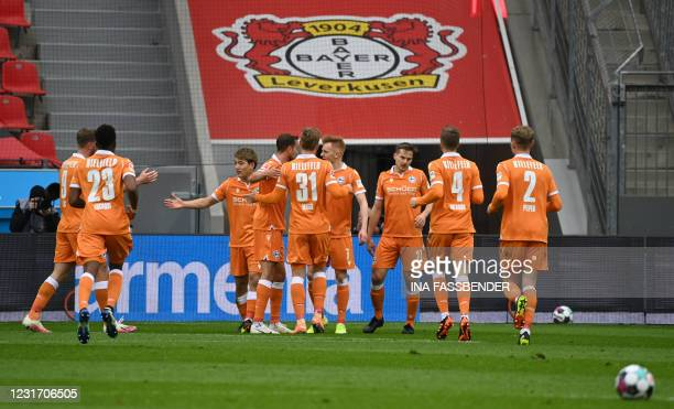 Bielefeld's Japanese forward Ritsu Doan celebrates with teammates after scoring the 0-1 during the German first division Bundesliga football match...