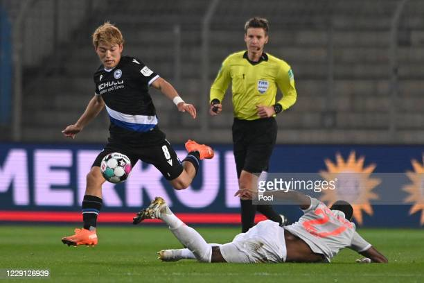 Bielefeld's Ritsu Doan in action against Bayern's David Alaba during the Bundesliga match between DSC Arminia Bielefeld and FC Bayern Muenchen at...