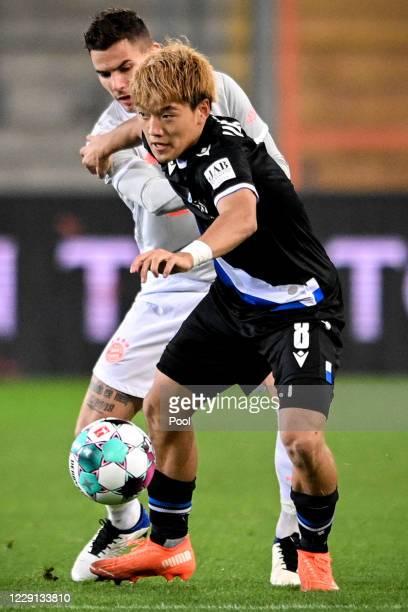 Bielefeld's Ritsu Doan in action against Bayern's Lucas Hernandez n action during the German Bundesliga match between Arminia Bielefeld and Bayern...